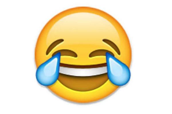 معنی ایموجی :صورت با اشک شادی